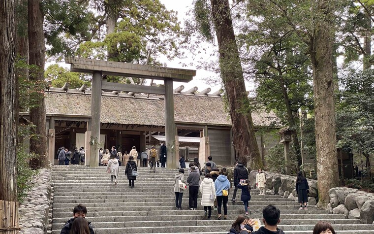 Tourists gathered on steps at the Ise Jingu in Mie prefecture, Japan